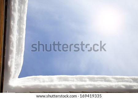 L shape snow roof edge with blue sky,material for designer - stock photo