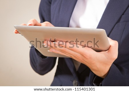 l woman working on a Person Using Modern Tablet Device.