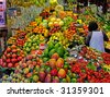 La Boqueria food market Barcelona Spain. Spanish world famous place, food marketplace, fruits market stall with mango, peach etc. - stock photo