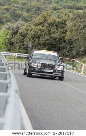LA CABRERA, SPAIN - APRIL 25th 2015: Madrid rally championship. Juan Carlos Lopez is driving his -Mercedes 190-, during the ascent to -La Cabrera-, on April 25th 2015. He finished 10th. - stock photo
