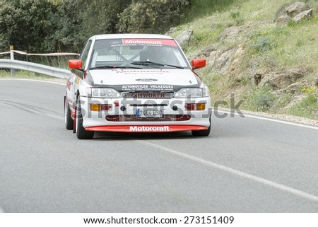 LA CABRERA, SPAIN - APRIL 25th 2015: Madrid rally championship. Ruben Velazquez is driving his -Ford Escort RS Cosworth-, during the ascent to -La Cabrera-, on April 25th 2015. He finished 5th. - stock photo