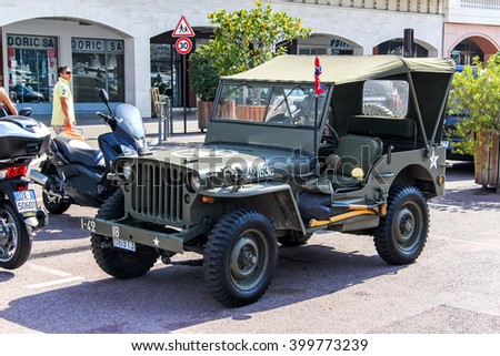 LA CONDAMINE, MONACO - AUGUST 2, 2014: American command car Willys MB in the city street.