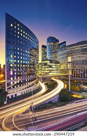 La Defense, Paris. Image of office buildings in modern part of Paris- La Defense during sunset. - stock photo