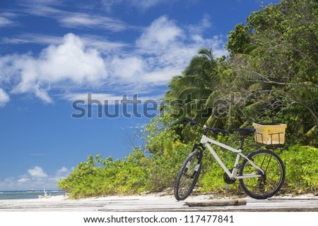 La Digue island, Seyshelles. The island of dreams for a rest and relaxation.Bicycle on moorage. - stock photo