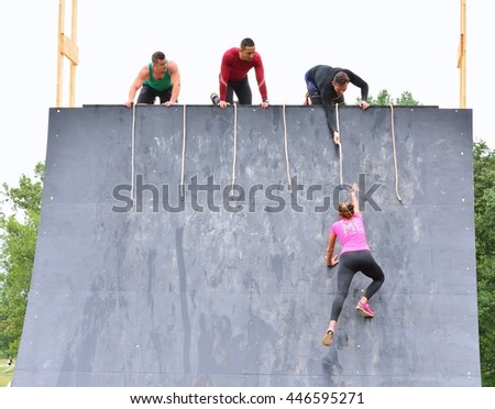 LA FRESNEDA, SPAIN - JULY 2: Gladiator Race, extreme obstacle race in July 2, 2016 in La Fresneda, Spain. People jumping, crawling,passing under a barbed wires during extreme obstacle race.