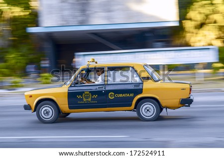 LA HABANA, CUBA - APRIL 23, 2009. Taxi driver whizzes through the streets of La Habana, Cuba on April 23, 2009. Cubataxi is the official national taxi service, the only usable by foreigners. - stock photo