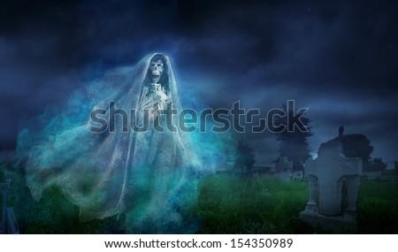 "La llorona, mexican scary ghost floating on a graveyard at night, seasonal Halloween ""dia de los muertos"" photo composite - stock photo"