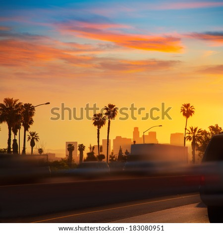 LA Los Angeles sunset skyline with traffic California from freeway - stock photo