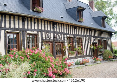 La Neuville-Chant-d'Oisel (Seine-Maritime, Haute Normandie, France) - Exterior of old half-timbered house with flowers - stock photo