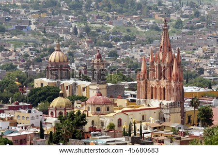 La Parroquia (Church of St. Michael the Archangel) and the Temple of the Nuns in the historic Mexican city of San Miguel de Allende. - stock photo