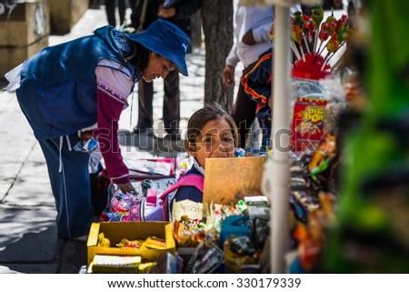 La Paz, Bolivia - Circa March 2015 -Girl in the streets of La Paz - stock photo