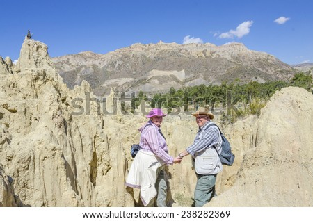 La Paz, Bolivia - Couple of senior tourists visiting Valle de la Luna (Moon Valley) - stock photo