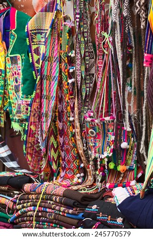 LA PAZ, BOLIVIA - NOVEMBER 10, 2014: Colorful bags, belts and textiles at a stand along the roadside in the city center on November 10, 2014 in La Paz, Bolivia - stock photo