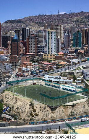 LA PAZ, BOLIVIA - OCTOBER 14, 2014: Unidentified people playing football on the pitch Cancha Zapata close to the Parque Urbano Central (Central Urban Park) on October 14, 2014 in La Paz, Bolivia - stock photo