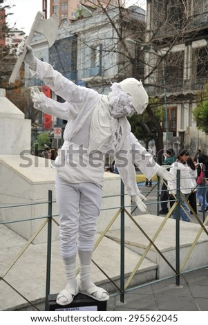 LA PAZ, BOLIVIA - SEPTEMBER 5, 2010: Living sculpture on the streets of La Paz. The actual capital of Bolivia, where most of the state institutions and the residence of the President of the country. - stock photo