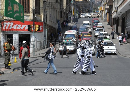 LA PAZ, BOLIVIA - SEPTEMBER 12, 2010: The actual capital of Bolivia, where most of the state institutions.Police dressed as a Zebra teach citizens the right way to cross the street. - stock photo
