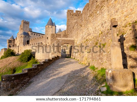 La Porte De Aude and cross at late afternoon in Carcassonne - France - stock photo