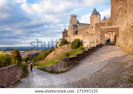 La Porte De Aude and street at late afternoon in Carcassonne - France - stock photo