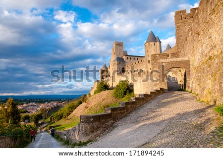 La Porte De Aude and street with great sky at late afternoon in Carcassonne - France - stock photo