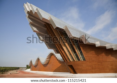 LA RIOJA, SPAIN - SEPTEMBER 22: Bodegas Ysios, Laguardia, La Rioja, Spain view on September 22, 2012. Santiago Calatrava designed the modern winery in the hills of Sierra de Cantabria for Ysios. - stock photo