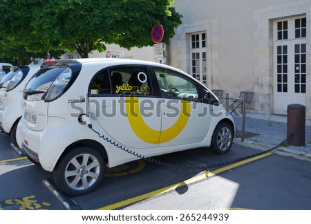 LA ROCHELLE, FRANCE - JUNE 24, 2013: Electric car Yelomobile recharging at the charging station. Since 1999, the 24/7 access to electric cars is provided using 13 stations in the city and suburbs - stock photo