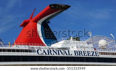 LA ROMANA, DOMINICAN REPUBLIC - NOV 24: Carnival Breeze docked in La Romana, Dominican Republic, as seen on Nov 24, 2015. It is a Dream-class cruise ship which entered service on June 3, 2012. - stock photo