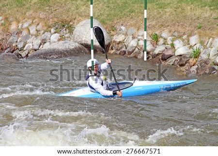 LA SEU D'URGELL, CATALONIA - MARCH 22: Unidentified sportspeople struggling with the flow. ICF Canoe Slalom training 22 March 2015 in La Seu d'Urgell, Catalonia. Parc Olimpic del Segre - stock photo