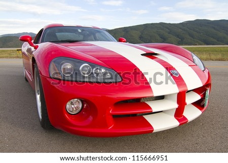 LA SEU D'URGELL, SPAIN - OCTOBER 6: A Dodge Viper SRT take part in Road and Track racing weekend organized by American Car Club, on October 6, 2012, in La Seu d'Urgell, Spain. - stock photo