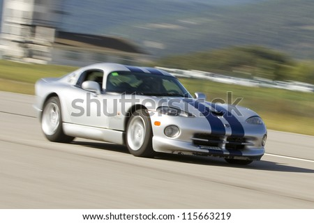 LA SEU D'URGELL, SPAIN - OCTOBER 7: A Dodge Viper take part in Road and Track racing weekend organized by American Car Club, on October 7, 2012, in La Seu d'Urgell, Spain. - stock photo