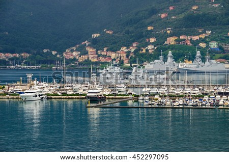 La Spezia, Italy - May 29, 2016: A general view of the city La Spezia, the chief Italian naval station and arsenal, from the sea, showing  marina and italian naval vessels