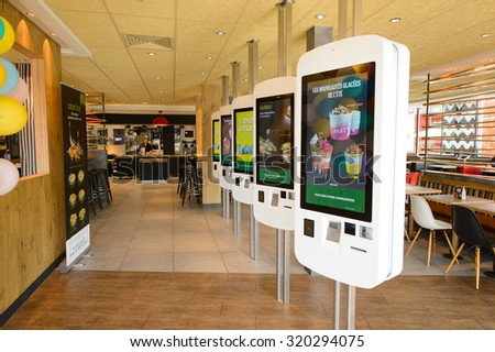 LA VILLE-AUX-DAMES, FRANCE - AUGUST 12, 2015: McDonald's restaurant interior. McDonald's is the world's largest chain of hamburger fast food restaurants, founded in the United States. - stock photo