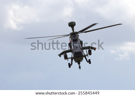 LAAGE, GERMANY - AUG 23, 2014: Eurocopter EC665 Tiger attack helicopter flying during a display at the Laage airbase open house. - stock photo