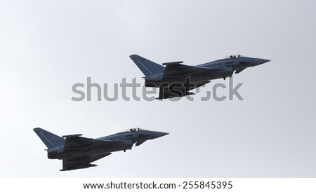 LAAGE, GERMANY - AUGUST 23: Two German Air Force Eurofighter Typhoons take off during the German Air Force Open Day at Tactical Air Force Wing 73 Steinhoff, Germany - stock photo