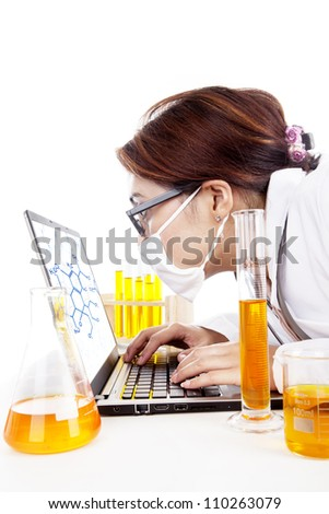 Lab assistant woman works with laptop and test-tubes in laboratory - stock photo