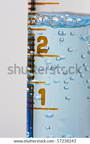 Lab chemistry - bubbles reaction in flasks closeup - stock photo