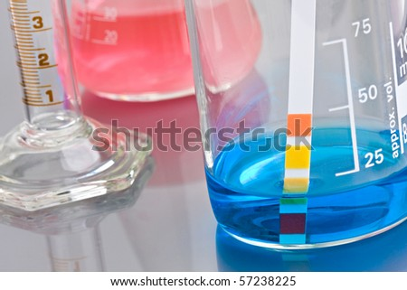 Lab chemistry - color flasks - shallow DOF - stock photo