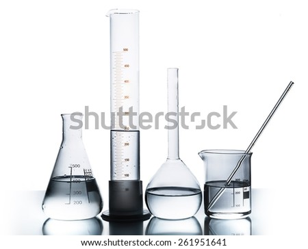 Lab. Laboratory glassware over reflective surface with white background - stock photo