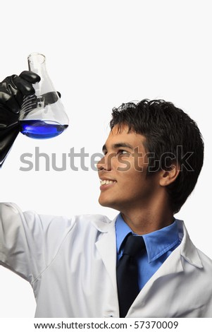 lab technician holding a flask with a fluid inside - stock photo