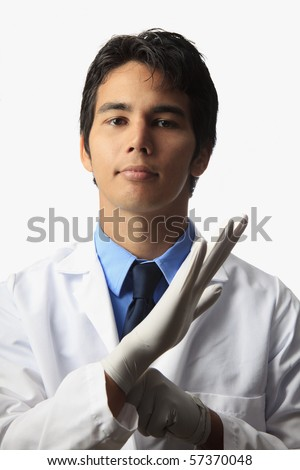 lab technician putting on his gloves - stock photo