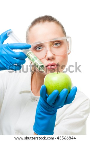 Lab woman make dollar injection into green apple