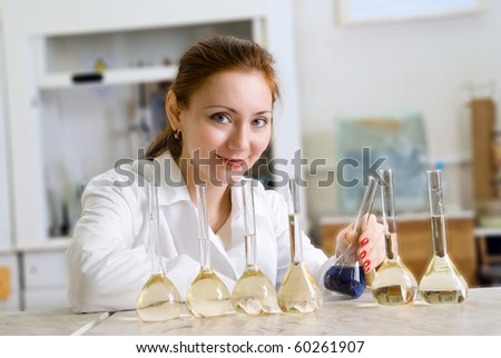 lab worker examines a flask with reagent - stock photo