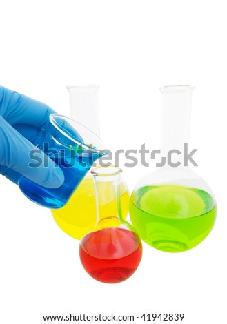 Lab workers hand pouring fluid from a beaker on a white background