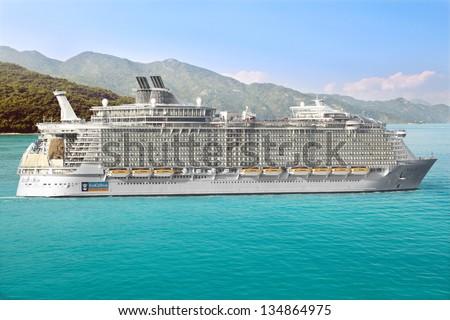 LABADEE, HAITI - FEBRUARY 26, 2013: Royal Caribbean cruise ship Allure of the Seas  Sails from Port Labadee in the Caribbean Island of Haiti on February 26, 2013. It's the largest passenger ship - stock photo