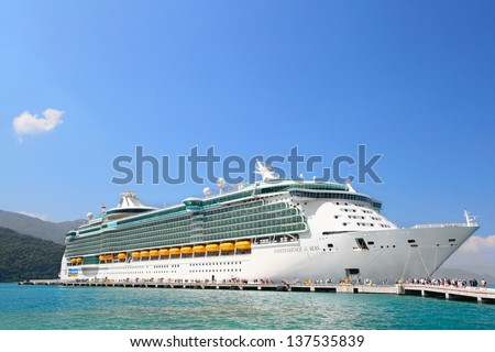 LABADEE, HAITI - FEBRUARY 28, 2013: Royal Caribbean cruise ship Independence of the Seas docked at the private port of Labadee in the Caribbean Island of Haiti on February 28, 2013. - stock photo