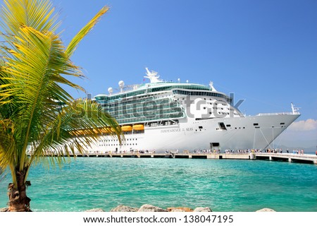 LABADEE, HAITI - FEBRUARY 26, 2013: Royal Caribbean cruise ship Independence of the Seas docked at the private port of Labadee in the Caribbean Island of Haiti on February 26, 2013. - stock photo