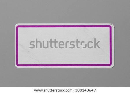 Label Adhesive Close Up on Grey Background with Real Shadow. Top View of Adhesive Paper Tag with Pink Border. Stickers with Copy Space for Text or Image