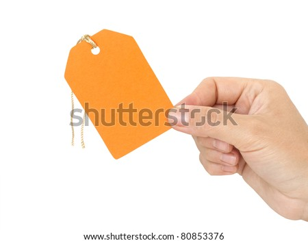 label in hand isolated on white - stock photo