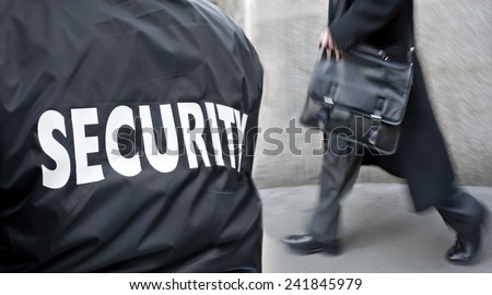 label inscription on the uniform of the security guard - stock photo