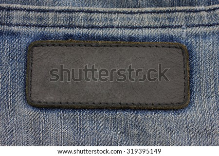 label sewed on a blue jeans. - stock photo