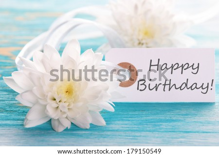 Label with Happy Birthday on wooden turquiose Background with white Flowers - stock photo